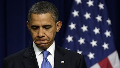 Obama-looking-down-frownAP