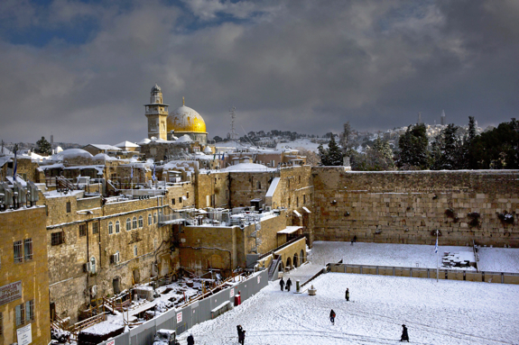 The Western Wall and the Dome of the Rock, two of the holiest sites for Jews and Muslims, are shown covered in snow in Jerusalem, Friday, Dec. 13, 2013. (AP Photo/Dusan Vranic)