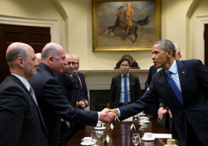 Anas Altikriti standing next to Iraqi Parliament Speaker Usama al-Nujaifi shaking hands with President Obama / Flickr